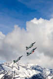 Swiss Air Force F-5E Tiger IIs in formation over the Alps. Royalty Free Stock Image