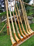 Swiss Alpenhorn instruments in a row Royalty Free Stock Image