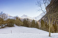 Swiss alpine landscape with Eiger, Monch and Jungfrau at horizon Royalty Free Stock Photos