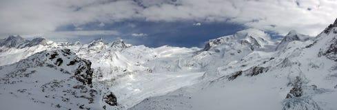 Swiss alpine panorama. With a glacier stock photo
