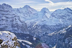 Swiss alpine peaks ridge at Jungfrau region  in winter Stock Photo