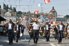 Swiss alpine shepherds. Carrying big cow bells along the streets of Luzern, Switzerland. A folkloristic event called Jodlerfest which took place on 27-29 June stock images