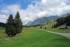 Swiss Alps. An alpine view in the Saentis area of the Swiss Alps on a day of mixed weather Royalty Free Stock Photos