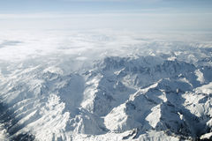 Swiss Alps. Alps from 30,000 feet. High altitude skies, jagged pinnacles and panoramic wilderness summits of this pristine mountain environment Stock Image