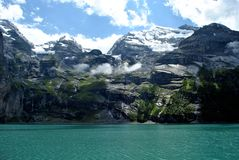 Swiss alps. Swiss mountain lake in the summer Stock Photos