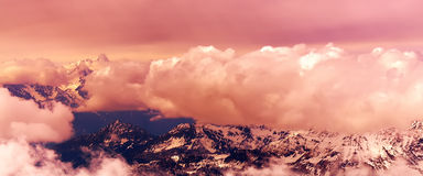 Swiss Alps. Aerial view of beautiful Swiss Alps surrounded by floating cloud in Zermatt, Switzerland stock image