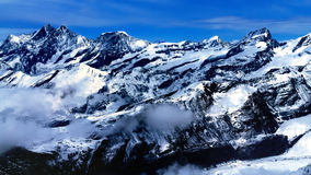 Swiss Alps. Aerial view of beautiful Swiss Alps surrounded by floating cloud in Zermatt, Switzerland royalty free stock photos