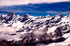 Swiss Alps. Aerial view of beautiful Swiss Alps surrounded by floating cloud in Zermatt, Switzerland royalty free stock image