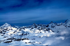 Swiss Alps. Aerial view of beautiful Swiss Alps surrounded by floating cloud in Zermatt, Switzerland royalty free stock photography