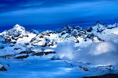 Swiss Alps. Aerial view of beautiful Swiss Alps surrounded by floating cloud in Zermatt, Switzerland stock photos