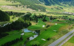 Swiss alps: Airshot from the golf course of Samedan. Switzerland: Airshot from the golfcourse in Samedan in the Upper Engadin royalty free stock photos