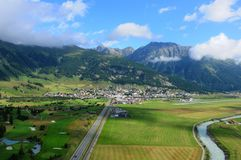 Swiss alps: Airshot from Samedan golfcourse, airport and train s. Tation in the upper Engadin in canton Graubünden stock photography