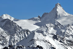 Swiss Alps: The Dent d'Herens. The Swiss ALps. The Dent d'Herens viewed from the west. In the centre, the Mont mines glacier, and the Tete Blanche Royalty Free Stock Photography