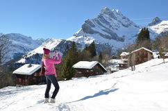 Swiss Alps. Girl taking a photo in the Swiss Alps Royalty Free Stock Photos