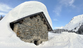 Swiss alps hut. After heavy snow Stock Photography