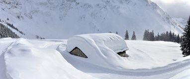 Swiss alps hut panorama. After heavy snow Stock Photography