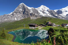 Swiss Alps Landscape. Landscape with Eiger, Moench and part of Jungfrau (to the right), in the Swiss Alps (Bernese Alps) reflecting in a pond at Kleine Scheidegg stock photography
