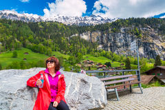 Swiss Alps.  Lauterbrunnen, Switzerland, Europe. Woman enjoying view of Swiss Alps in Lauterbrunnen, Switzerland, Europe Royalty Free Stock Photo