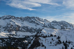 Swiss alps. Light captures the rocky detail of the Swiss alps as the last moments of sunshine pass Royalty Free Stock Photos