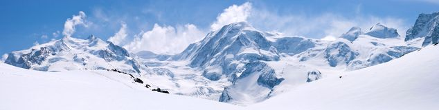 Swiss Alps Mountain Range Landscape. Panorama of Snow Mountain Range Landscape with Blue Sky at Matterhorn Peak Alps Region Switzerland Royalty Free Stock Photo