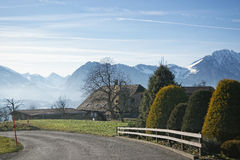Swiss Alps mountains view while crossing the village in winter Stock Photo