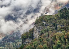 Swiss Alps mountains view. Little old church high on a cliff in Swiss Alps stock images
