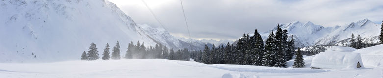 Swiss alps panorama 2. Swiss alps panorama with hut and wood Royalty Free Stock Photography
