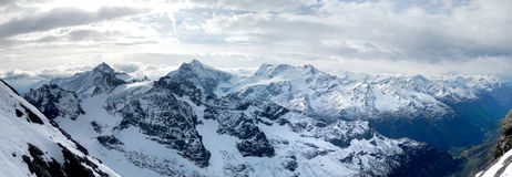 Swiss Alps Panorama. Panoramic view of the Swiss Alps from the top of Mount Titlis in Switzerland royalty free stock photo