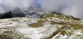 Swiss Alps - panoramatic. Summer iand winter n the Swiss Alps stock images