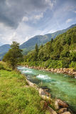 Swiss Alps river. Clean mountain river in swiss Alps, Europe Stock Photos
