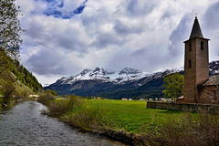 Swiss Alps-river Inn and Sils Baselgia Royalty Free Stock Photography