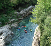 Swiss Alps river with kayaks Stock Photos