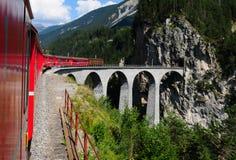 Swiss Alps: Unesco world heritage train trip through canton Gra. Ubünden up to Davos and St. Moritz royalty free stock photo