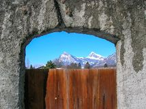The Swiss Alps through a vineyard gate Royalty Free Stock Photos