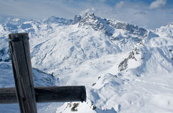 Swiss alps in winter with cross on peak Stock Image