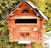 Swiss Alps and wooden mail box stock photos
