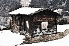 Swiss Alps and wooden shed, vintage hues Stock Photography