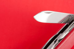 Swiss army knife. Red Swiss army knife on red background stock photos