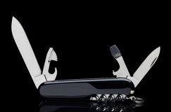 Swiss army knife. On black stock images