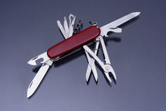 Swiss army knife. Close up of fully opened multipurpose knife Royalty Free Stock Photo