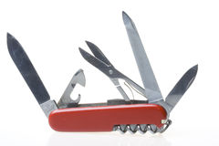 Swiss army knife. Opened red swiss army knife isolated on white background stock images