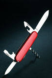 Swiss army knife. On black background stock images