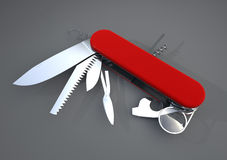 Swiss army knife. Opened with many tools available  on gray background Stock Image