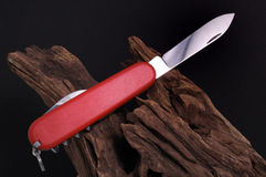Swiss army Knife and Wood Royalty Free Stock Photography