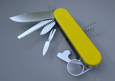 Swiss army knife yellow. Swiss army knife opened with many tools available  on gray background Royalty Free Stock Images