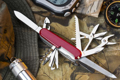 Swiss Army Style Knife - Great Outdoors. A Swiss Army style of mulitool knife and equipment for the great outdoors stock images