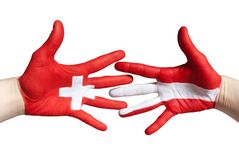Swiss and austrian handshake Stock Photography
