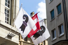Swiss and Basel Canton Flags. One Swiss flag in between two flags of the swiss canton of Basel royalty free stock images