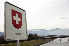 Swiss border sign. On the Rhine river royalty free stock photo