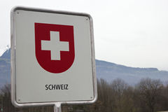 Swiss border sign. On the Rhine river stock photo